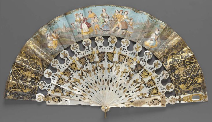 Mid-19th century, Europe - Fan - Printed and painted paper. Front and back edges have gilt on black, scroll and floral patterns. Center front shows a skating scene, center back a landscape of a house by the shore. Sticks of mother of pearl carved in foliage motifs accented with gilt.