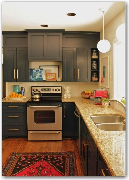 paint soffits same color as cabinets to make them look taller. Love the framing too!