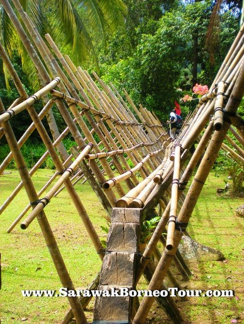 Watch your step when you cross the Bidayuh Bamboo bridge!