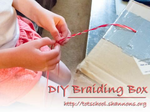 Braiding Box! Cut a hole in a cardboard box, tie three strand of string/ribbon in a knot, pull the untied strands through the hole, and tape the knot to the other side of the hole.
