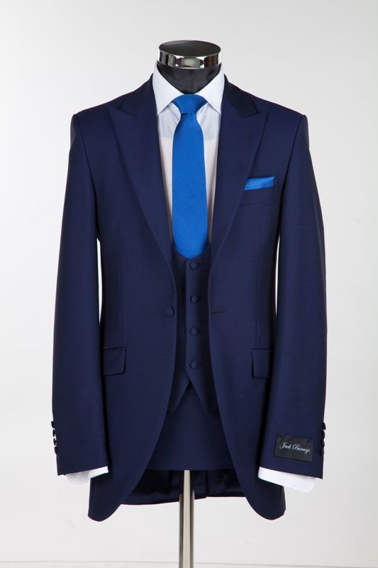 Royal Blue Three Piece Slim Fitting Wedding suit from Jack Bunneys but with a purple tie