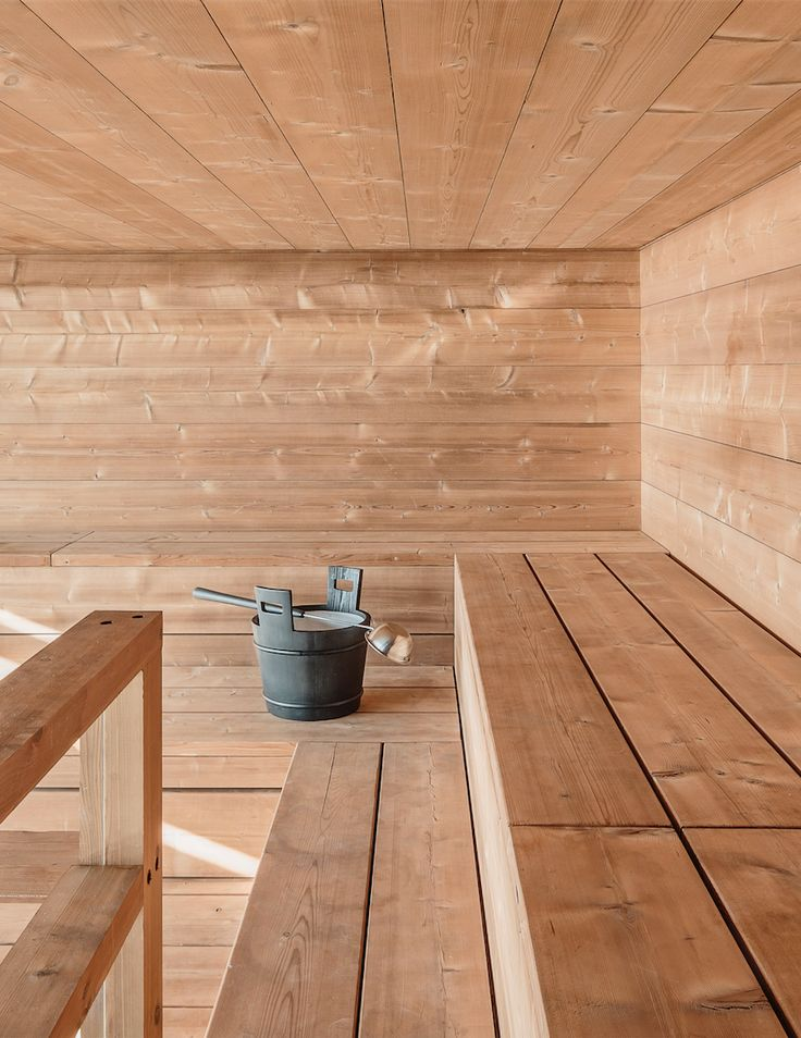 Beautiful wooden Finnish Sauna, Löyly public sauna and restaurant in Helsinki, designed by Avanto Architects. photograph by Kuvio.com featured on Martyn White Designs luxury blog.