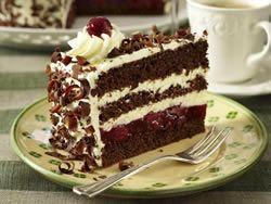 Schwaezwald Kirschtorte - This is a rich chocolate cake with a filling of whole black cherry jam. It is a speciality from the Bavarian area of southern Germany, famous for its cakes. The cake is best made 4 or 5 days in advance and stored in an airtight tin or wrapped in foil. It should not, however, be assembled until just before serving.