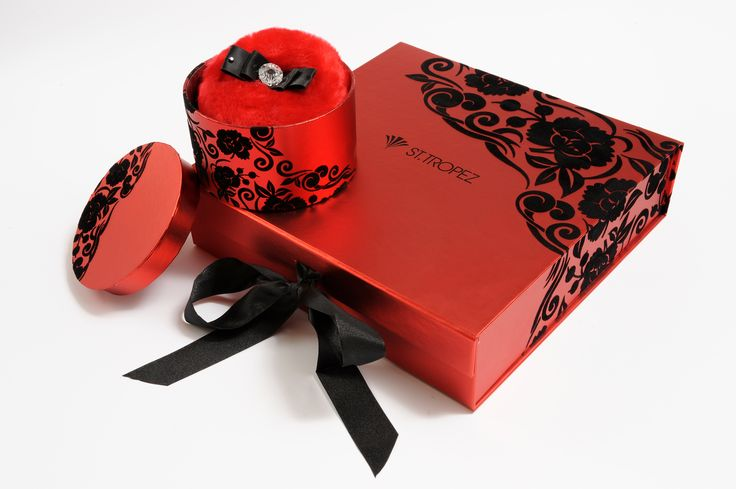 St Tropez red foil gift box with black flock printing. Shimmer puff in matching red foil tub. Designed, developed and manufactured by Foldabox.
