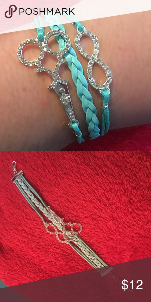 Hairstylist Bracelet Super cute yet simple handmade bracelet. Charms are silver toned. Turquoise chords. Lobster clasp and chain on the back. Makes a great addition to your tip the next time you are at the salon Jewelry Bracelets
