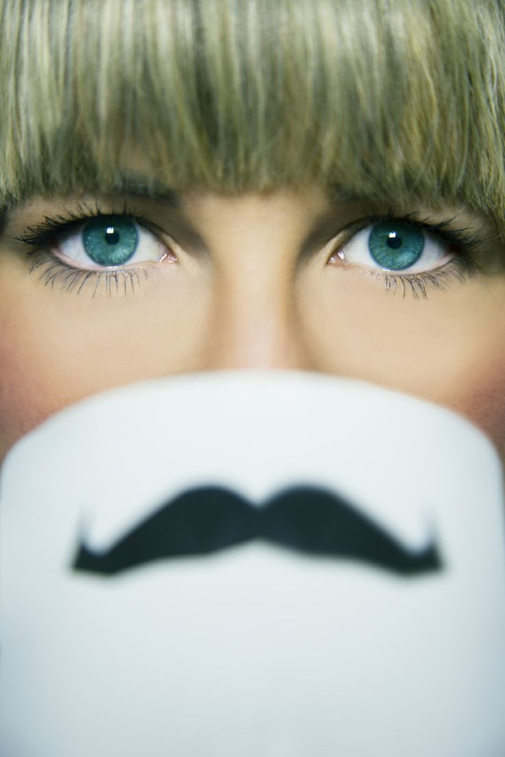 Movember portraiture woman funky moustache portraits retouching mug blue eyes beauty