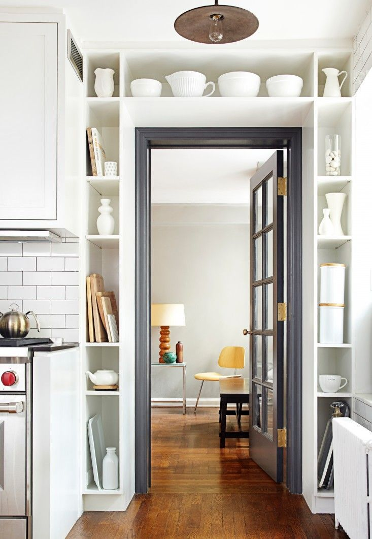 i love the way they added built in storage around the doorframe