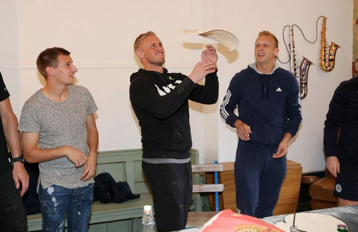 Marc Albrighton and Ritchie De Laet watch Kasper Schmeichel during Leicester City's visit to Peter Pizza