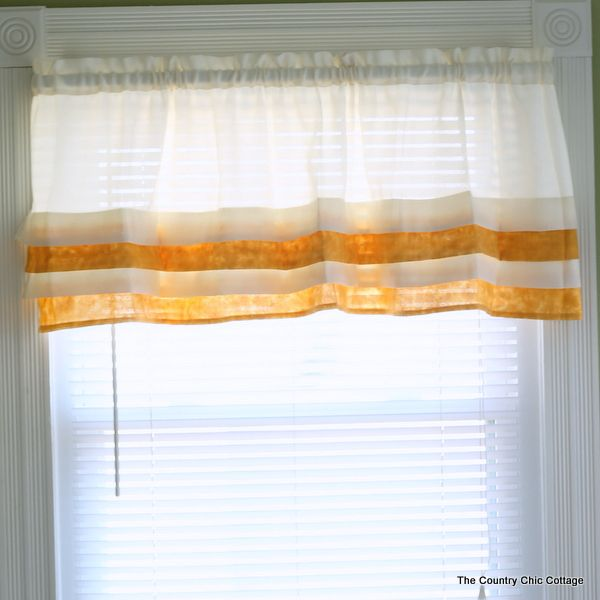 Metallic Gold Tiered Valance -- paint curtains with metallic gold paint and this super simple technique.
