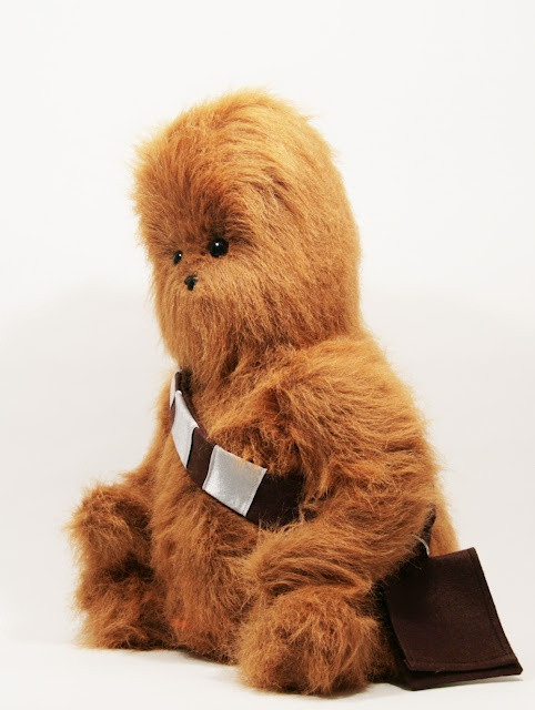 Wookie the Chew stuffed animal. Sadly, one of a kind, but you can find a link to a Sasquatch stuffed animal that uses the same pattern and could pass for Chewie if you added the accessories.