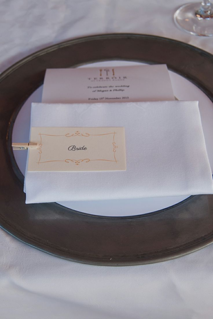 Place cards attached to menus with small wooden pegs