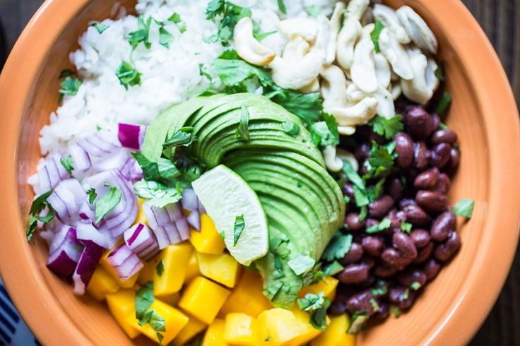 Vegan Brazilian Bowls are loaded with creamy coconut rice, black beans, mango, avocado, and cashews. My favorite flavors from Brazil!