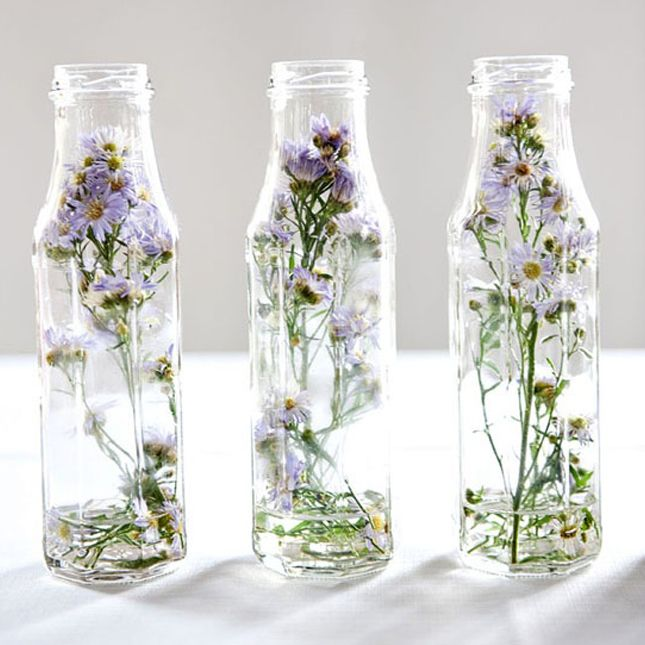 Display dried flowers by encasing them in a glass jar.