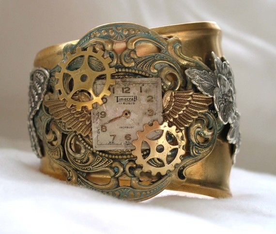 oooh... love this steam punk inspired clockwork bracelet.