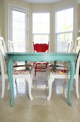The single red chair at the head of the table perfectly accentuates this dining room ensemble.