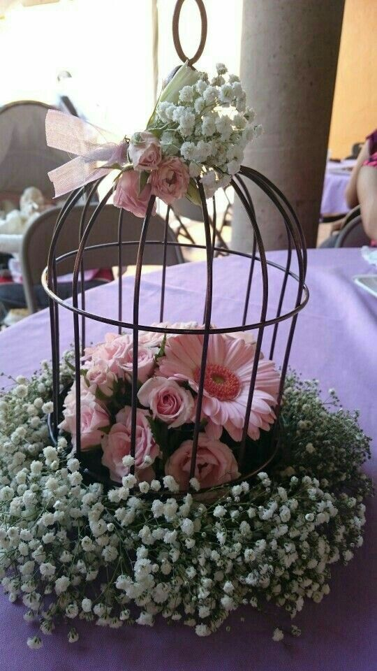 Beautiful shabby chic birdcage centrepiece with baby