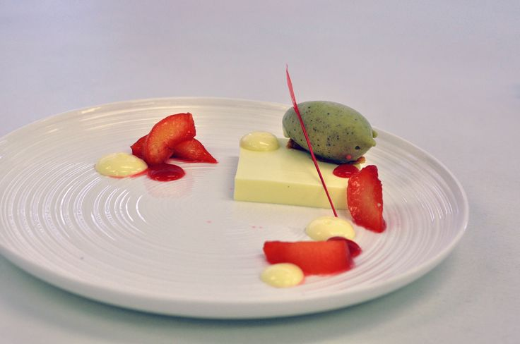 Buttermilk panna cotta, poached plums and almond nougat tuillw
