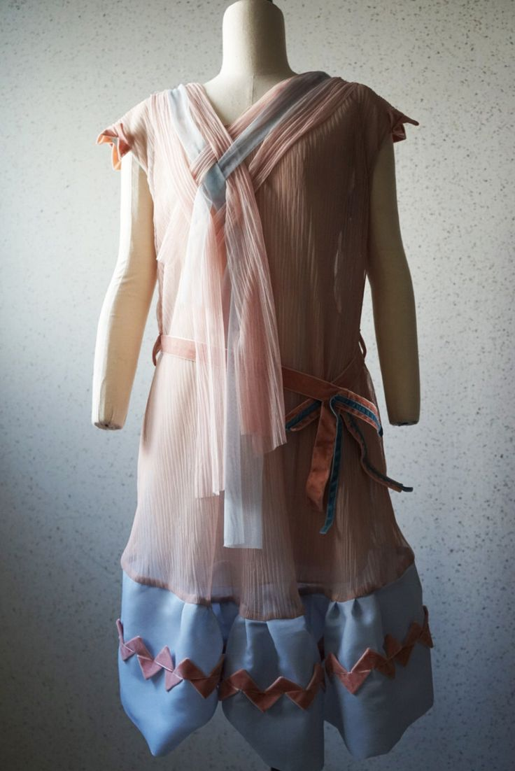 A personal favorite from my Etsy shop https://www.etsy.com/listing/253836268/unbalanced-v-necktulle-dress-vintage