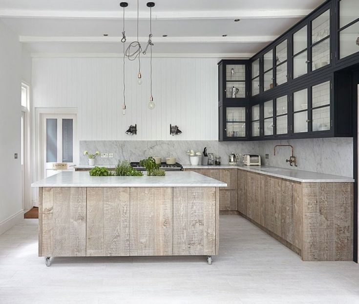 Light and airy white-washed wood mixed with dark uppers: http://www.stylemepretty.com/living/2015/01/23/20-gorgeous-non-white-kitchens/
