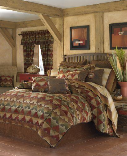 """Croscill Santa Fe Queen Comforter Set by Croscill. $299.99. Dry clean only. Both the comforter and the shams are trimmed with leather piping. Face: 80% Rayon/20% Polyester (Back): 100% Cotton. Coordinating decorative pillows and window treatments are available. Bedskirt has split corners to accommodate footboards. Set includes one queen comforter, one queen bedskirt and two standard pillow shams. Croscill's """"Santa Fe"""" is a rustic southwestern ensemble in a warm des..."""