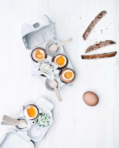 Simplicity of the food and styling. Love the white background. The different sizes of the boxes and the open eggs