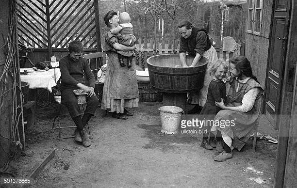 a family doing the laundry in their allotment garden in berlin around 1910 germany 1900 1920. Black Bedroom Furniture Sets. Home Design Ideas