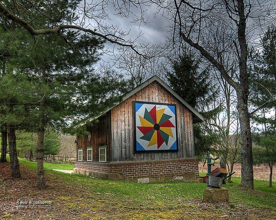 Quilted barn/shed A barn quilt is a large piece of wood that is painted to look like a quilt block. Typically put on barns and large sheds. On barns they run 8x8. Sheds 2x2 or however much space you have.