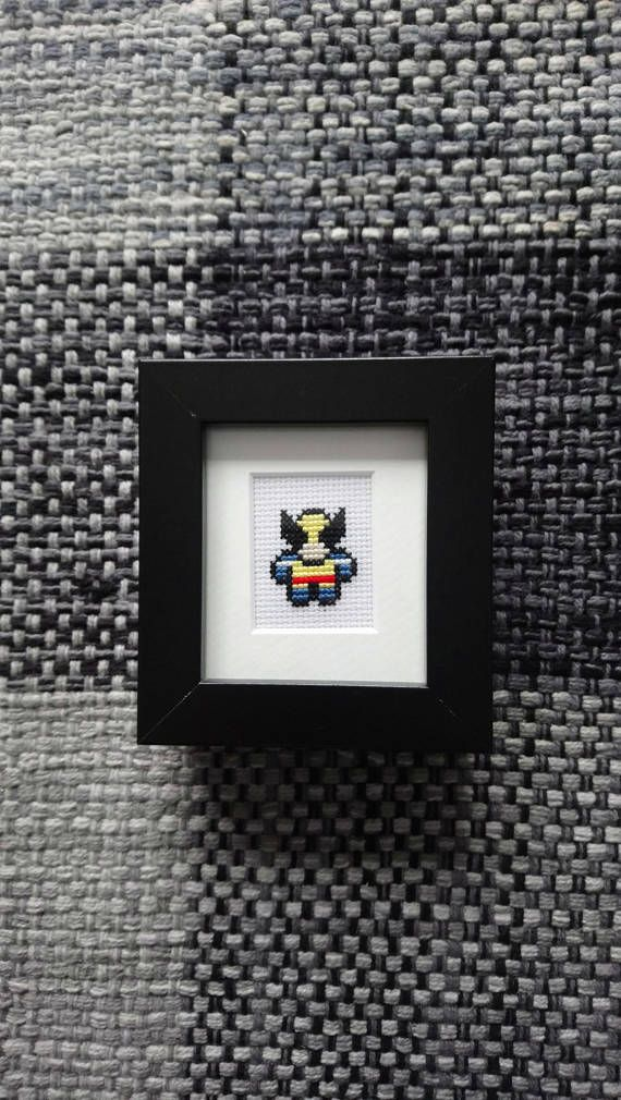 Marvel Wolverine Cross Stitch in black frame and mount