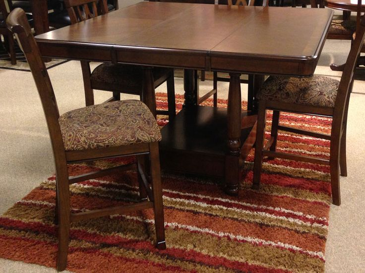 Leahlyn Counter Height Extension Dining Room Table With The Rich Brown Cherry Color Finish Flowing Beautifully