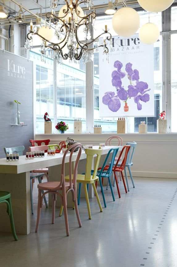 white table, mis-match colourful chairs