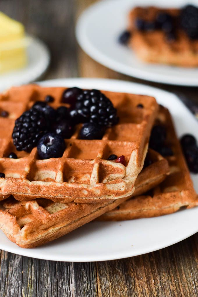 4 ingredient banana waffles with almond butter! This healthy, delicious breakfast is flourless, dairy free, and paleo. Quick and easy to make!