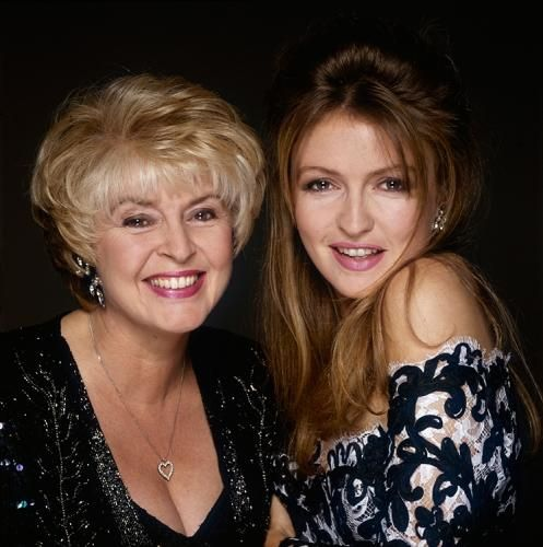"""Gloria Hunniford With Caron Keating 2 by Terry O'Neill   Irish television presenters Gloria Hunniford and her daughter Caron Keating (1962 - 2004), circa 1995.  Limited Edition C-Print Signed and Numbered  16"""" x 16"""" / 20"""" x 20""""  24"""" x 24"""" / 30"""" x 30""""  40"""" x 40"""" / 48"""" x 48"""" / 60"""" x 60"""" / 72"""" x 72""""  For questions or prices please contact us at info@igifa.com     IGI FINE ART"""