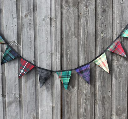 OH!!!  Like, all the family names....   Cute idea for wedding decorations - tartan bunting!