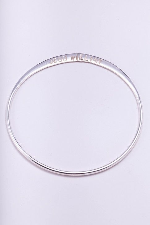 This dainty, delicate bangle is gorgeous and simple, and chimes delightfully when worn together with other pieces. It is the perfect size to inscribe a small message, name, or initials and dates. It is the ideal gift when you'd like to purchase something special for several people – the ultimate thank you gift for your bridesmaids, or for the god-mothers of your precious children. The beautiful design is striking in its simplicity. $60.00 http://www.marliandmo.com.au