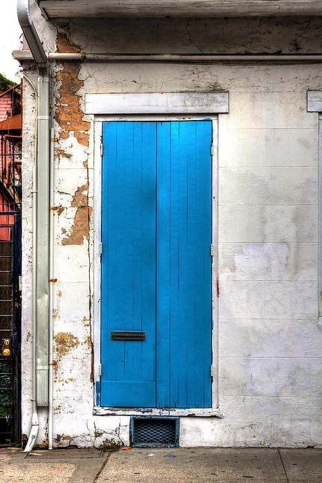 a blue  double door in the french quarter of new orleans