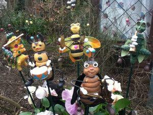 Garden Plant Pot Sticks. A Band of Garden Bugs Playing Instruments