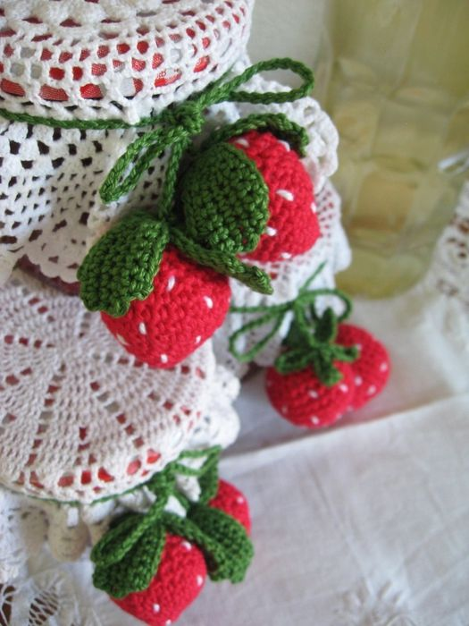 Crochet Strawberries. Not in English but bet I can find another pattern somewhere on the net. Love how they put them with a doily around a jar.