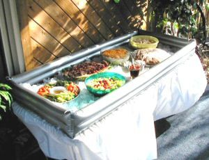 IDEA for keeping food chilled on hot party days.  USE a kiddie pool filled with ice.