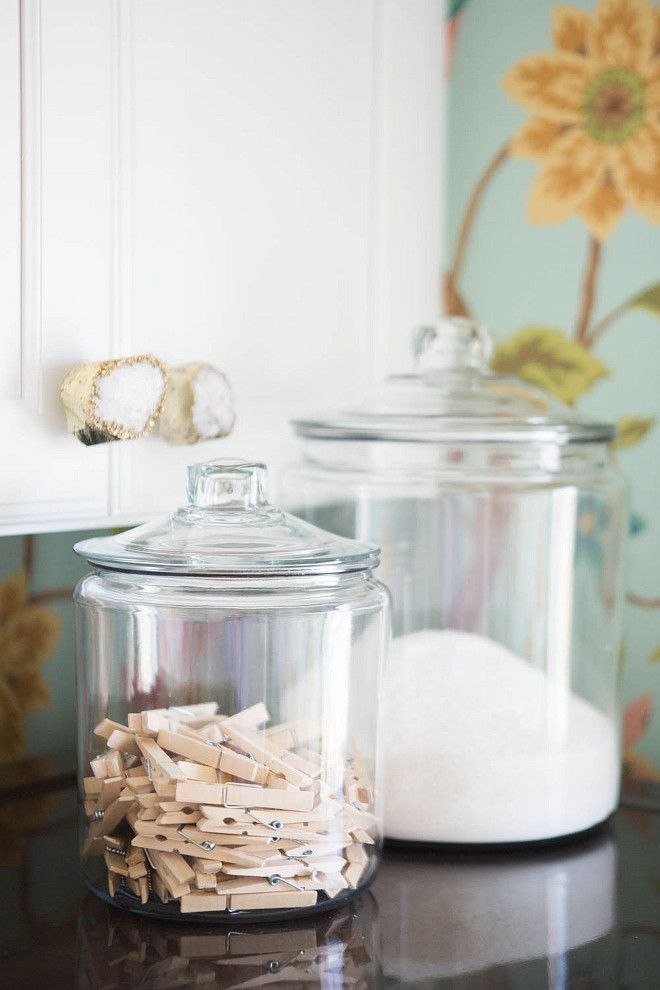 Laundry Room Canister. Laundry room with with white shaker cabinets adorned with purple quartz knobs, Anthropologie Crowned Quartz Knobs and canisters. #LaundryRoom House of Jade Interiors.