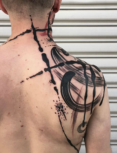 Abstract watercolor brush stroke tattoo by Tim Mueller