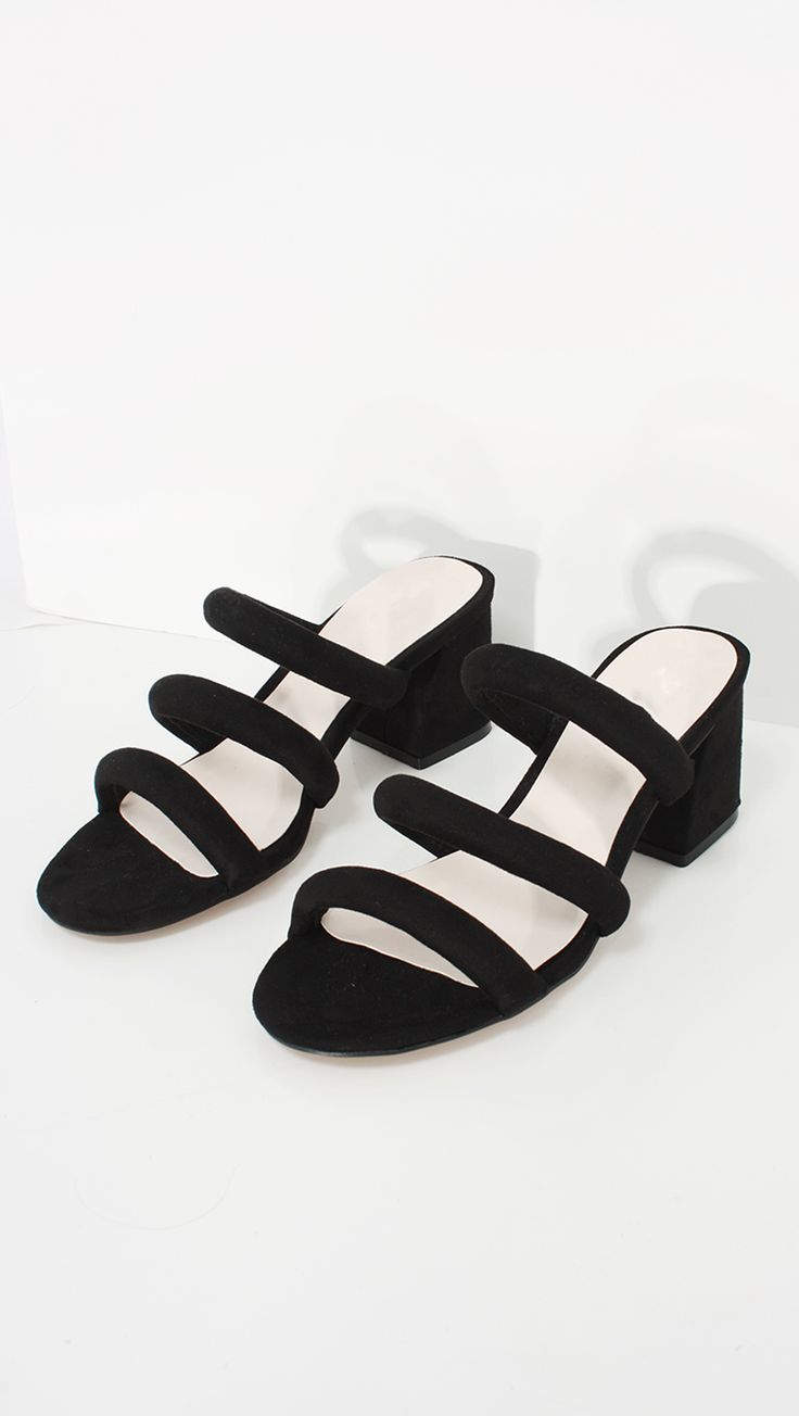 Faye Mule, a suede slide in Black. Features synthetic leather insole and  interior,