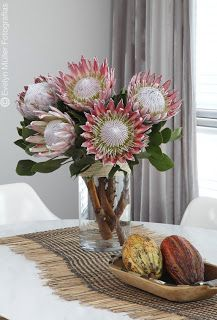King Protea - one single amongst other flowers in bridal bouquet. Any more would be flippin heavy as shit