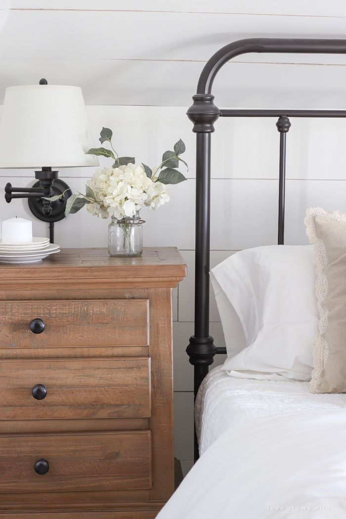 This cozy master bedroom is beautifully decorated