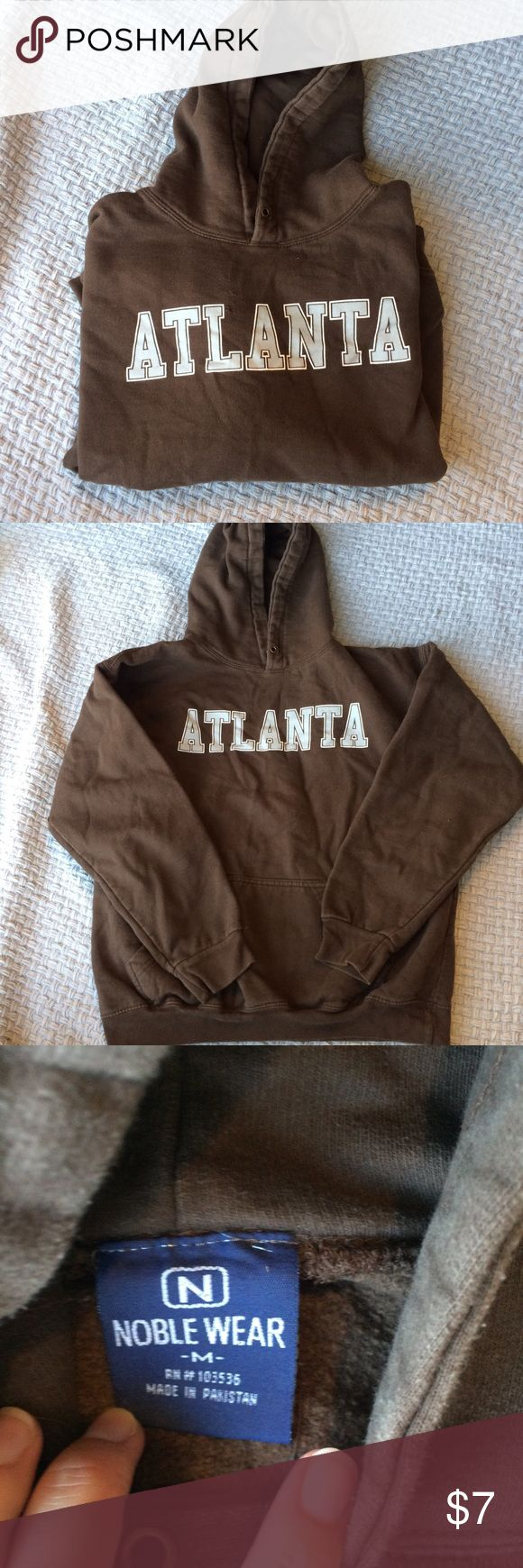 Atlanta, Georgia Airport Hoodie From the Atlanta Airport, size M, chocolate brown hoodie with kangaroo pocket. Note here is NO drawstring in the hood, and some wear holes in the front, pictured. It's comfy cozy though! Tops Sweatshirts & Hoodies