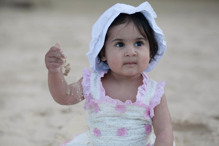 baby girl at the beach for the first time in her life