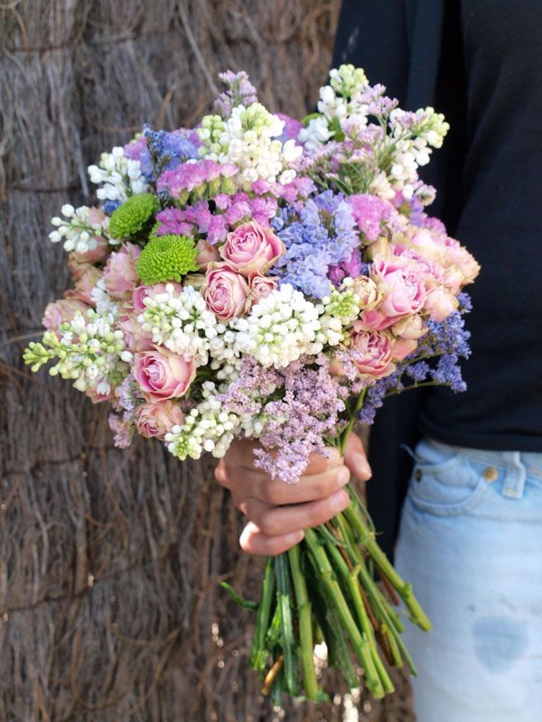 Lilac bouquet with roses, green button mums and statice and stock. Love it