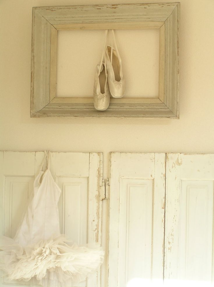 pointe shoes in a frame. hanging/framing objects instead of pictures on the wall.