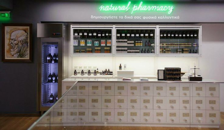 """In the entry way of our """"agora"""" stands the NATURAL PHARMACY where our customers can create their personal cosmetics with the guidance and help of our specialist qualified pharmacist. #theAPIVITAexperienceStore #Apivita #NaturalProducts #InteriorDesign #Architecture"""