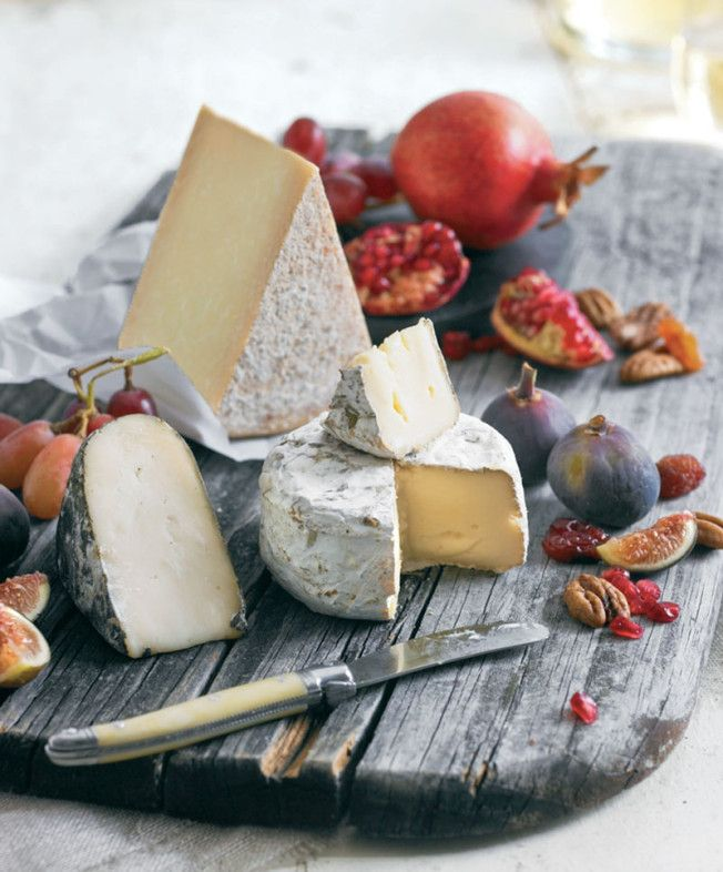 Fall Cheese Plate: during cooler months we like to serve richer, more aged cheeses. Figs, pomegranates, grapes, pears and persimmons add a bright and flavorful juiciness to the plate.