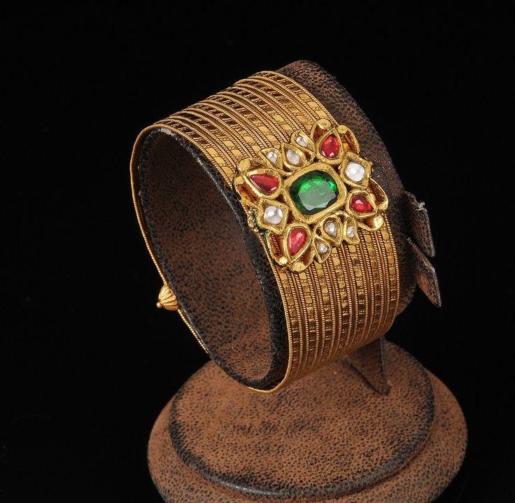 Gold kada studded with emerald,ruby and kundan